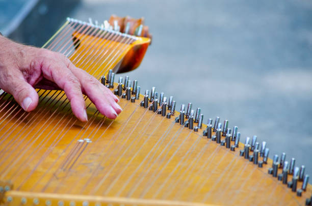 Cтоковое фото Antique closeup stringed musical instrument bandura and male hand