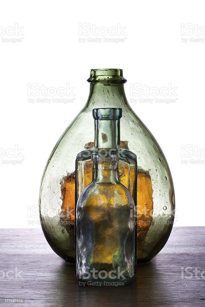 Antique color glass bottles stock photo