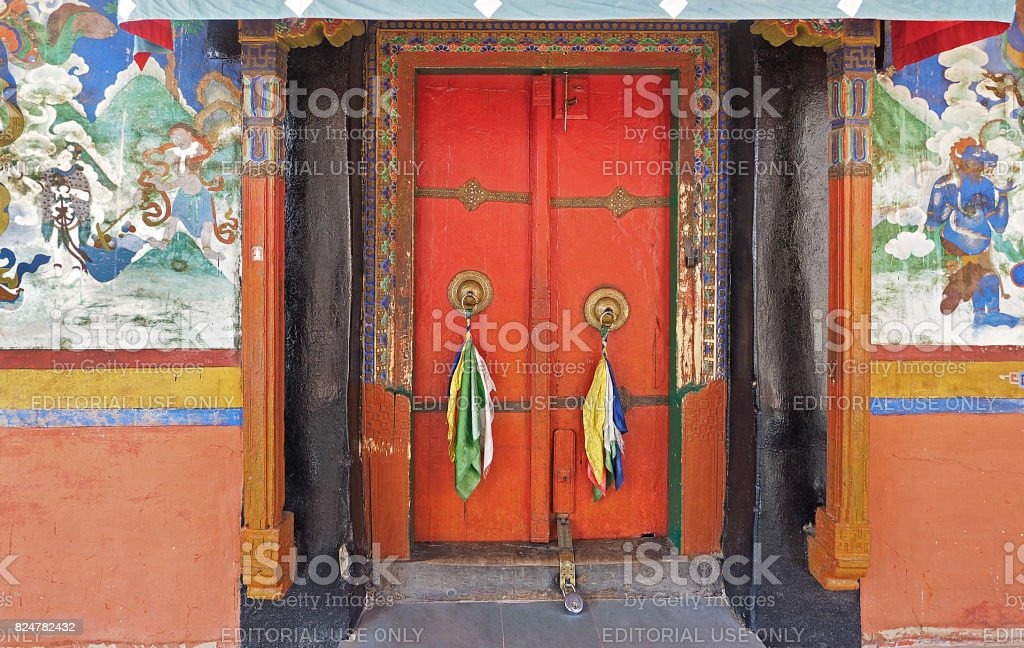 antique colorful Bhudda architec and wall paint at Likr Monastery, Leh India stock photo