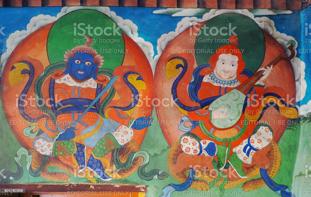 antique colorful Bhudda wall paint at Likr Monastery, Leh India stock photo