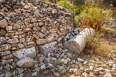 istock Antique column in a stone fence of an olive grove 1247841127