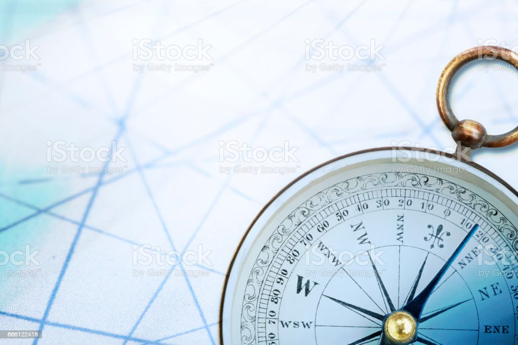 Antique Compass On Old Map With Gridlines stock photo
