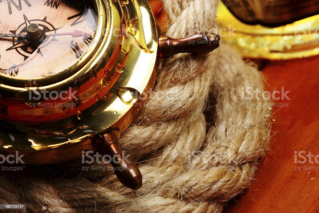 Antique compass on rope royalty-free stock photo