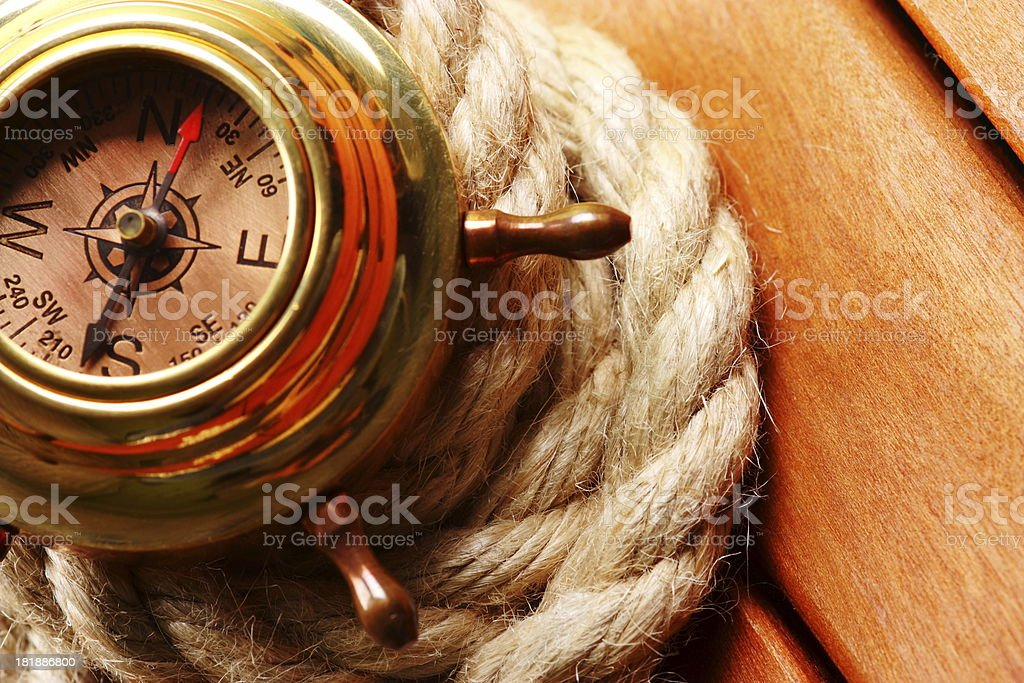 Antique compass on rope stock photo