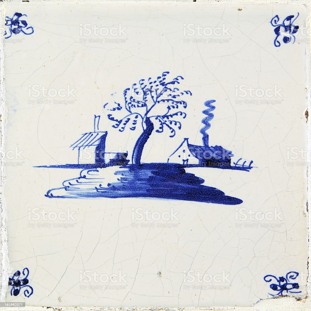 Antique Delft Blue and white tile stock photo