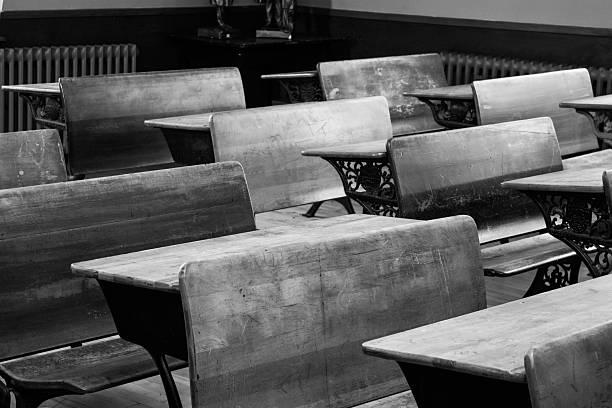 Antique desks in school house stock photo