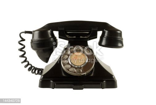 istock Antique dial telephone isolated on white with clipping path 144340725