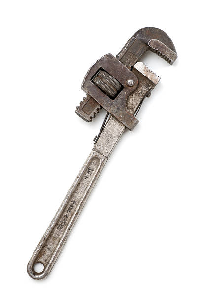 Antique Dirty Rusty Pipe Wrench Antique pipe wrench, dirty, rusty, battered, isolated on white background. adjustable wrench stock pictures, royalty-free photos & images
