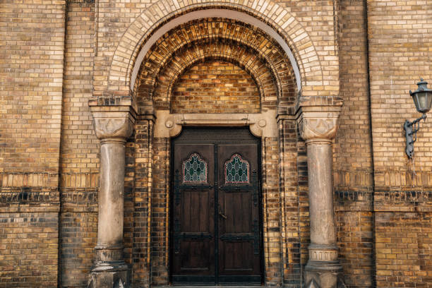 Antique door and brick wall at Novi Sad Synagogue in Serbia stock photo