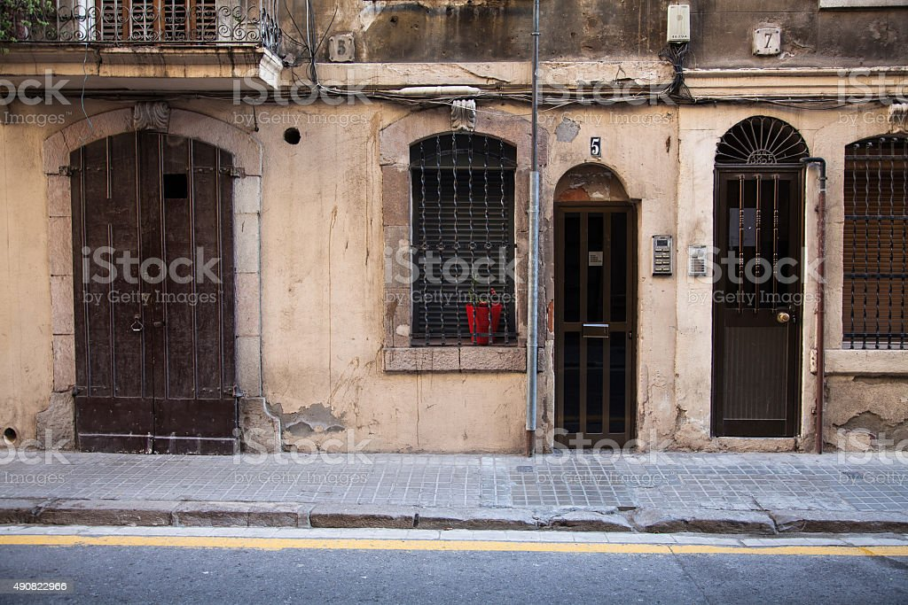 Antique door and old wall in the street. stock photo