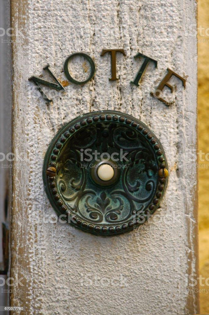 Antique door bell button stock photo