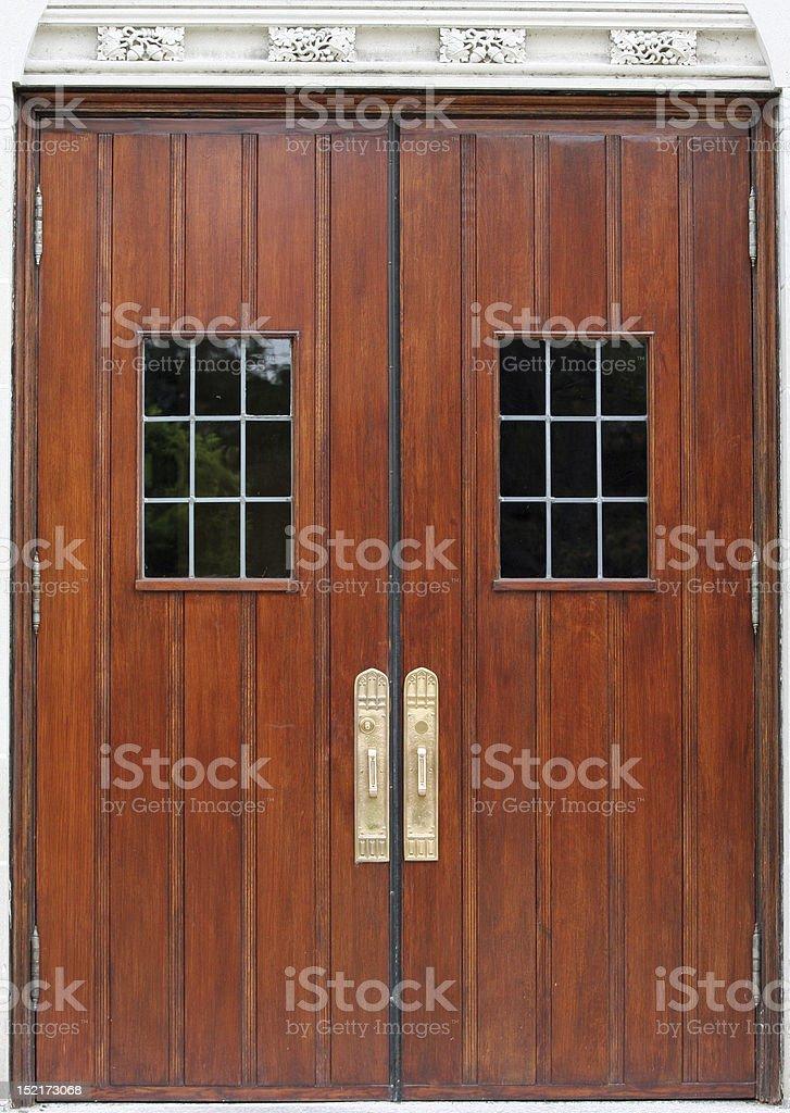 Antique Double Doors Antique Double Doors with windows and handles Brown Stock Photo