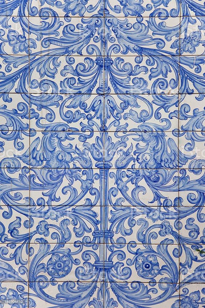 antique dutch delft design on blue tiles stock photo