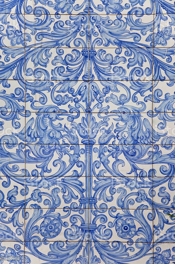 Antique Dutch delft design on blue tiles stock photo