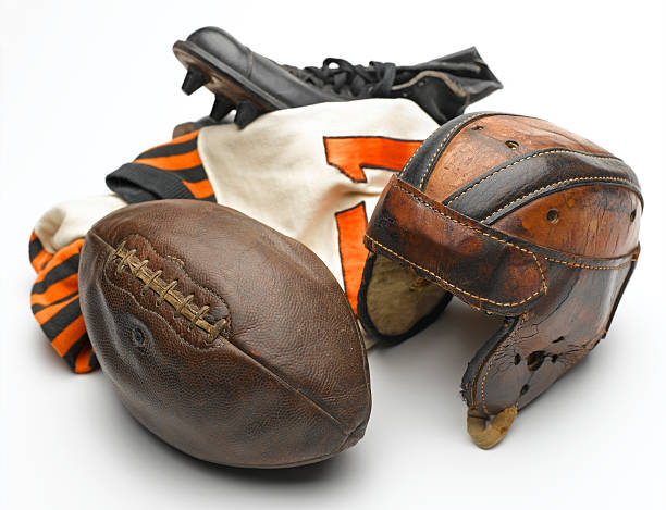 Antique Football Equipment A classic group of American football sports equipment. american football uniform stock pictures, royalty-free photos & images