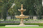Old Fountain is in the park in summer.