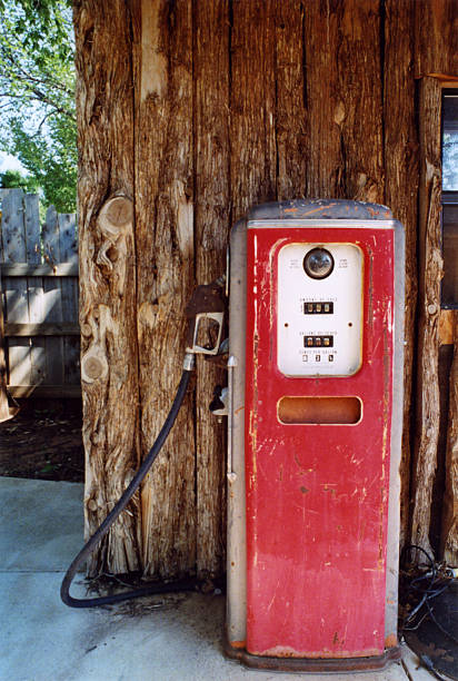 Antique Gas Pump With Log Wall stock photo