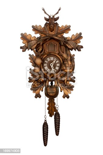 Isolated on white photography of an original antique german cuckoo clock.