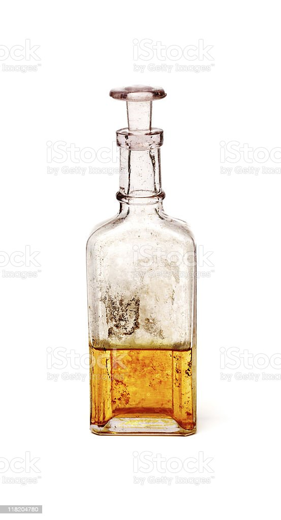 Antique glass bottle containing golden liquid royalty-free stock photo