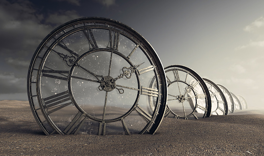 A line of half buried antique clocks with a glass backing in a sandy desert landscape - 3D render