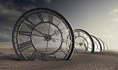 istock Antique Glass Clocks In The Desert 1279083466