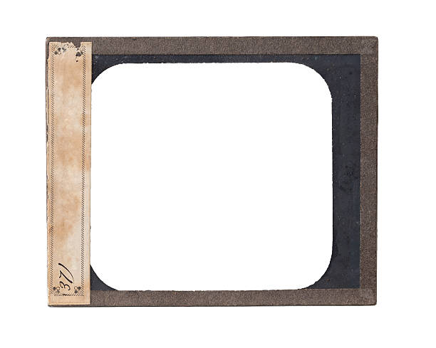 Antique Glass Plate Negative Metal Frame A antique glass plate negative with paper label and clipping path.  Please see my portfolio for other film backgrounds and textures.   negative image technique stock pictures, royalty-free photos & images