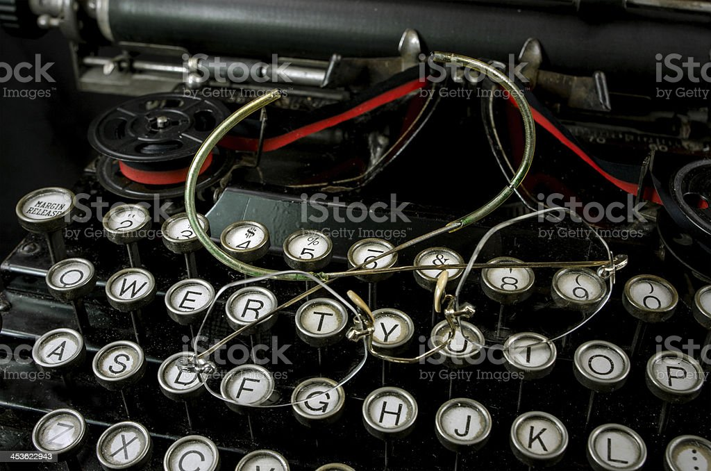 Antique Glasses and Typewriter stock photo
