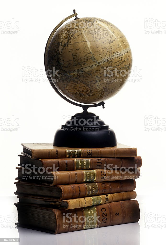 Antique Globe on a pile of old Books royalty-free stock photo