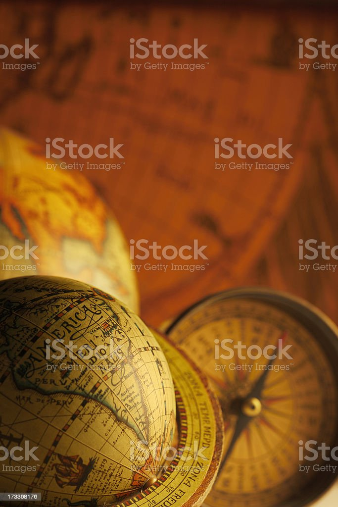 Antique Globes And A Compass in Front Of Old Map stock photo