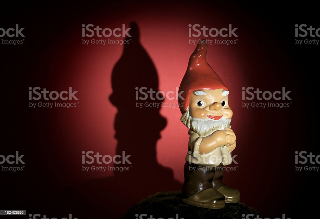 Antique Gnome Dramatically Lit stock photo