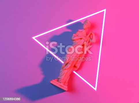 istock Antique goddess figurine. 80's synth wave and retrowave glowing triangle futuristic aesthetics. Old fashioned abstraction concept 1206894386