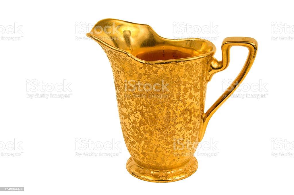 Antique gold cream serving dish stock photo
