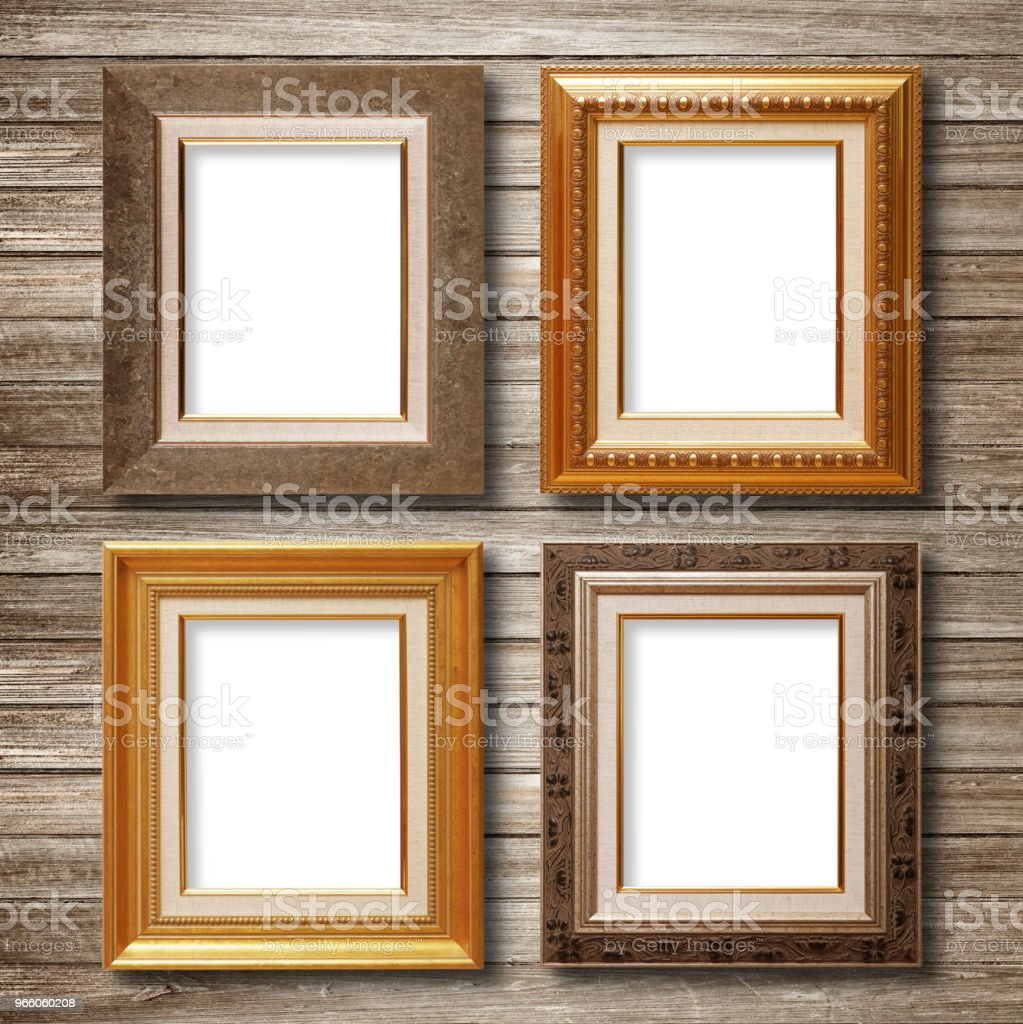 Vintage gold frame auf hölzernen Wand - Lizenzfrei Alt Stock-Foto