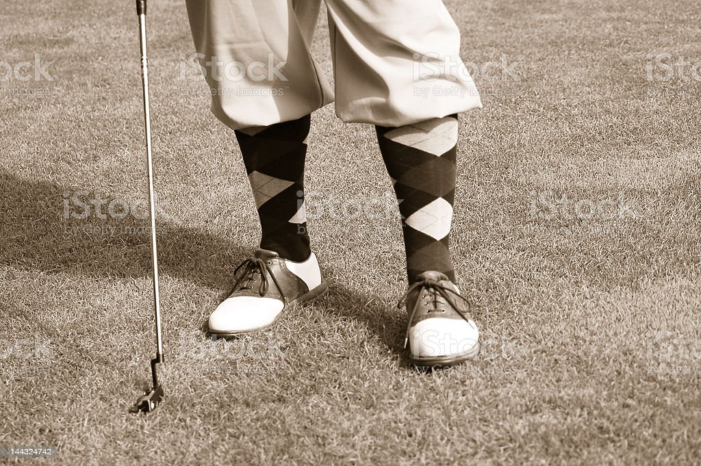 Antique golfer feet stock photo