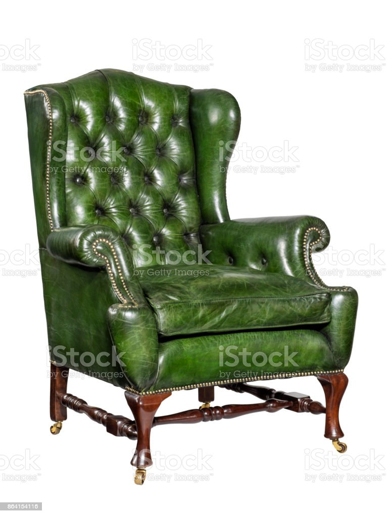 antique green leather wing chair carved legs isolated royalty-free stock photo