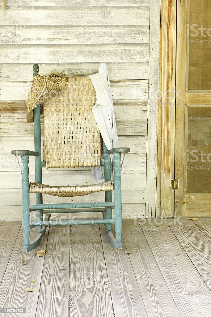 Antique Green Rocking Chair On Rustic Farm Porch stock photo