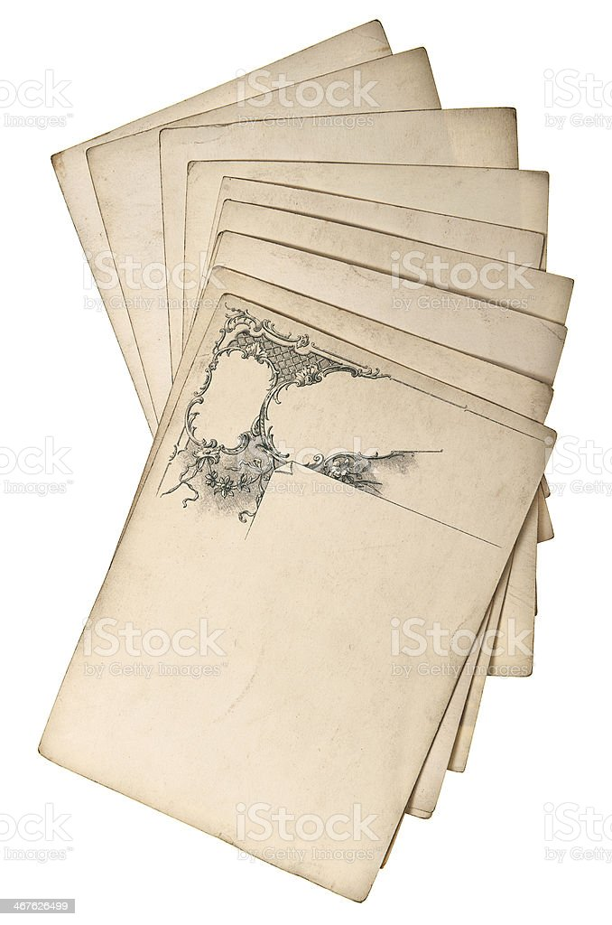 Antique Grungy Paper Sheets With Ornate Swirl Stock Photo