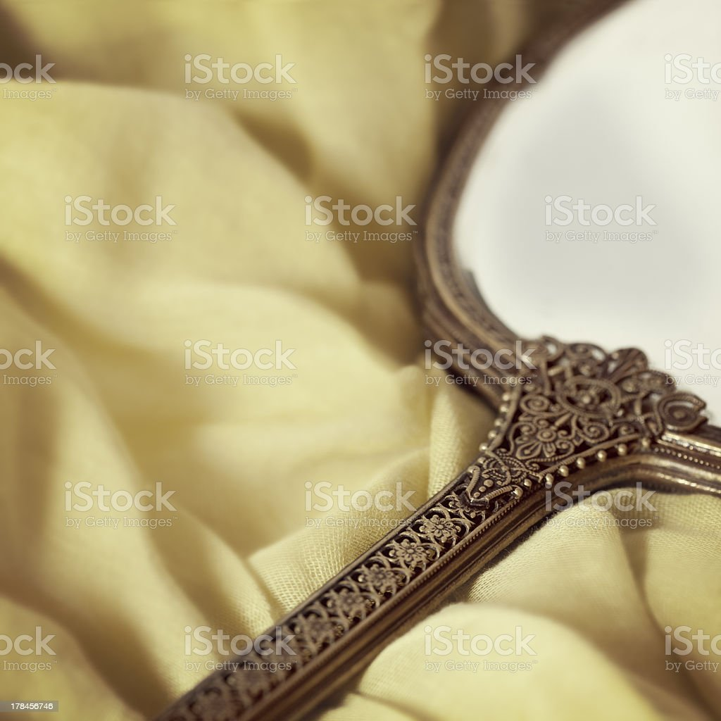 Antique Hand Mirror over Soft Fabric stock photo