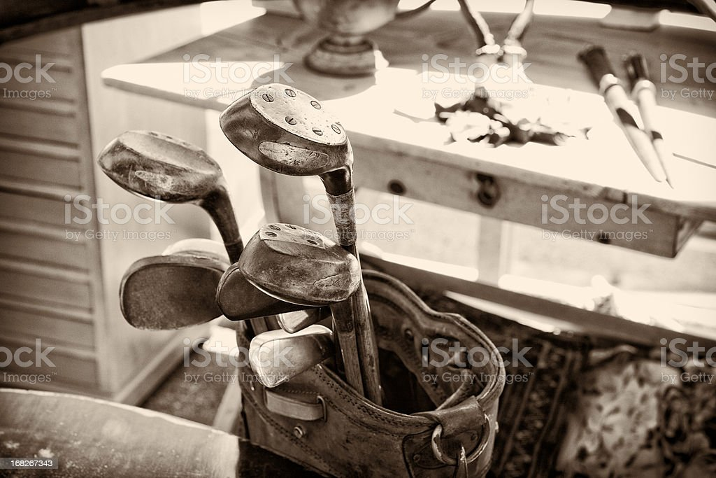 Antique handmade golf clubs, monochromatic, sepia tone stock photo