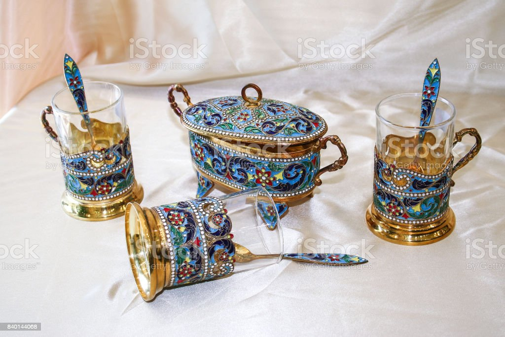 Antique handmade Persian Enamel Gold Tea Set consisting of a Sugar cube holder long Tea spoons and Cups with handle  from city of Isfahan, Russian Cloisonne stock photo
