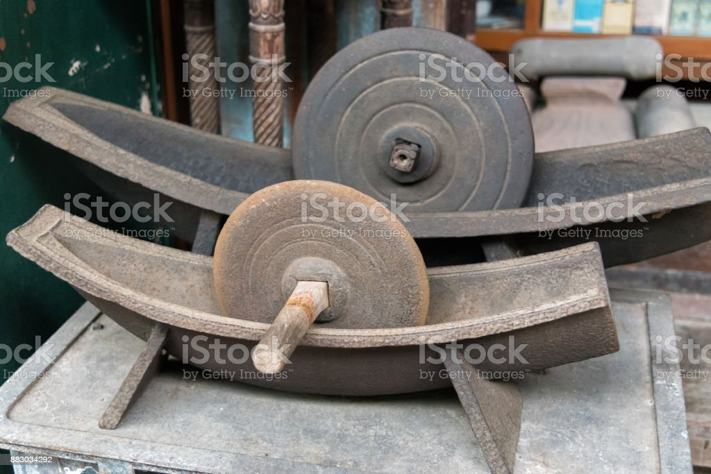 Antique herb roller mill grinding tool for make medicine. stock photo