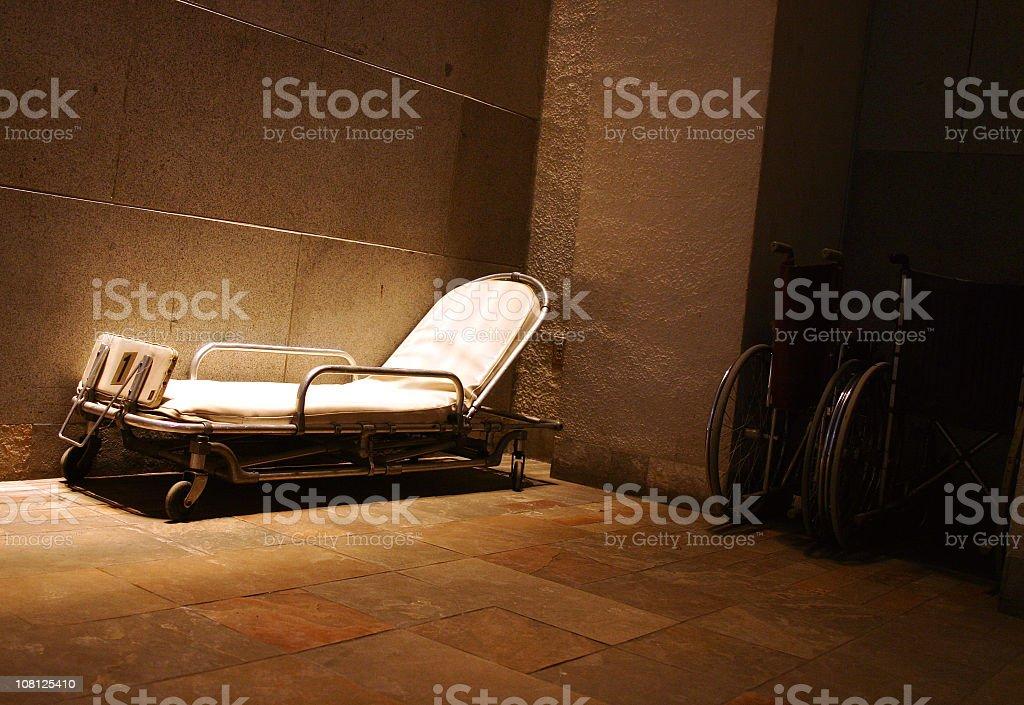 Antique Hospital Bed in Dark Hallway stock photo