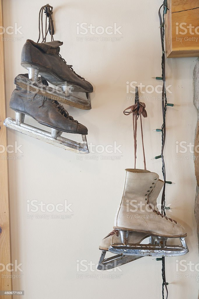 Antique ice skates hanging on a wall. stock photo