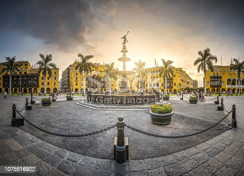 View of the sunset of the antique iron pool of the main square of Lima, Peru.