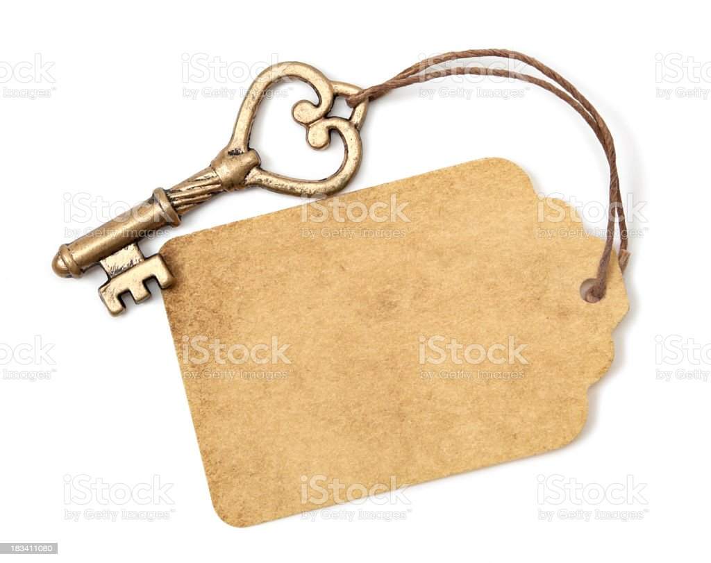 Antique key and label royalty-free stock photo