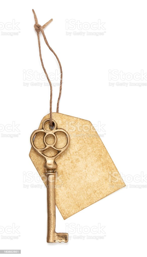 Antique key and tag stock photo