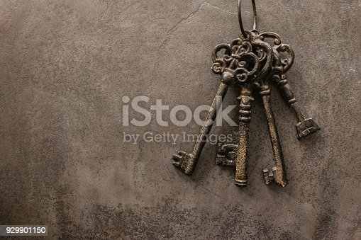 antique keys on old steel metal texture background