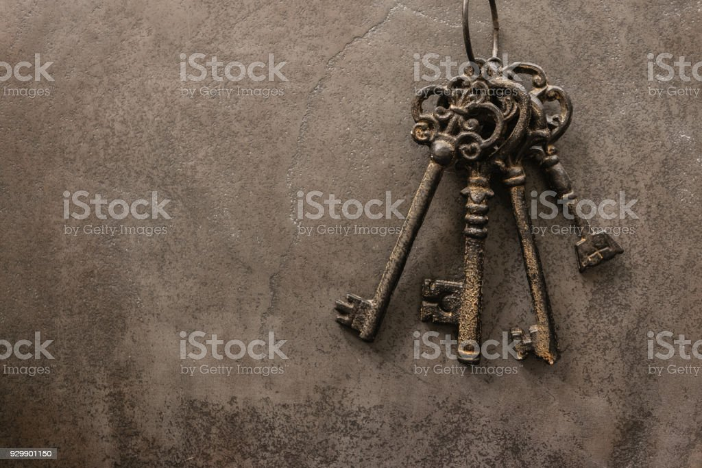 antique keys on old steel metal texture background stock photo