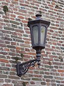 Antique lantern on a brick wall
