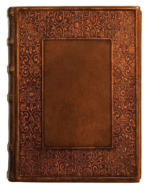 Antique Leather Book Cover Centuries old leather book with intricate border. hardcover book stock pictures, royalty-free photos & images